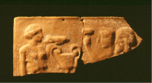 Seated couple plaque