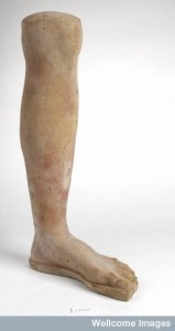 L0035894 A clay-backed leg and foot. Roman votive offering