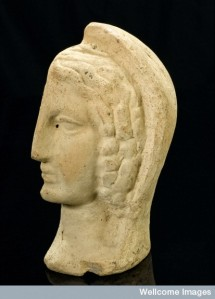 L0058482 Left half of a a terracotta female head, Roman, 200 BCE-200