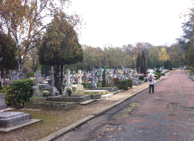 Visitor entering the cemetery with flowers